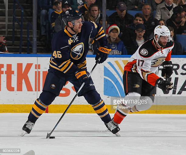 Cody Franson of the Buffalo Sabres skates against Ryan Kesler of the Anaheim Ducks during an NHL game on December 17 2015 at the First Niagara Center...