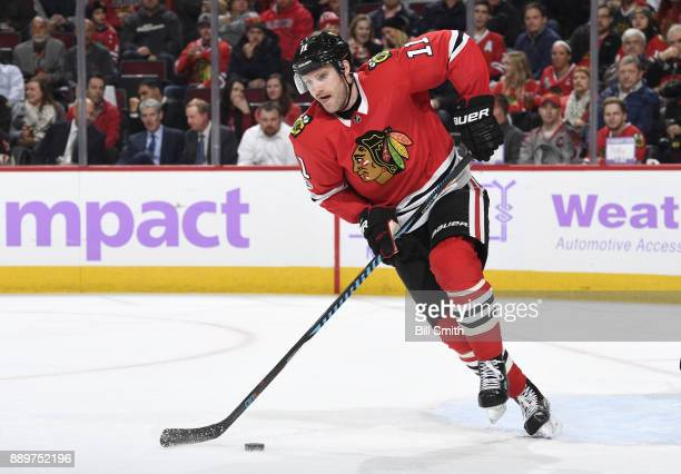 Cody Franson of the Chicago Blackhawks controls the puck in the second period against the Anaheim Ducks at the United Center on November 27 2017 in...