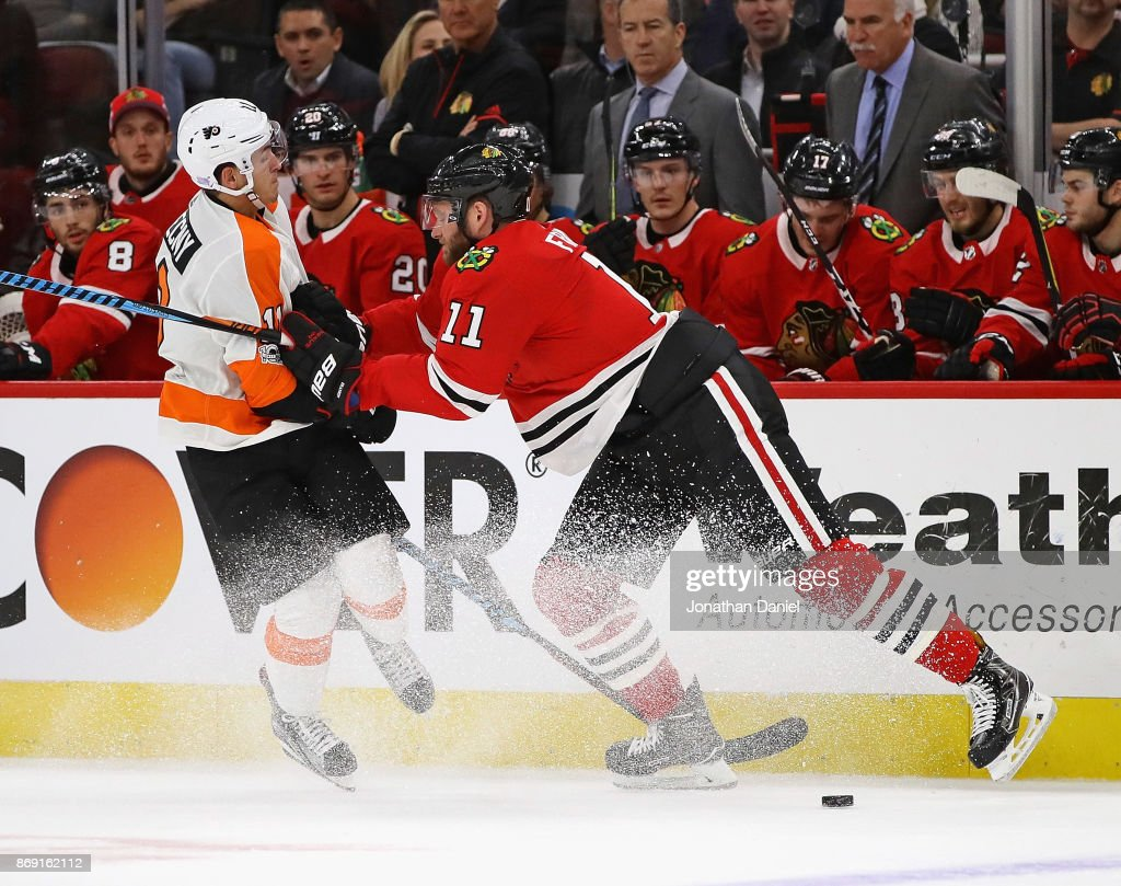 Cody Franson #11 of the Chicago Blackhawks hits Travis Konecny #11 of the Philadelphia Flyers at the United Center on November 1, 2017 in Chicago, Illinois.