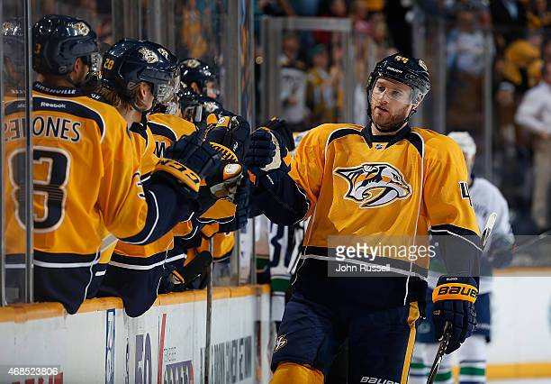 Cody Franson of the Nashville Predators celebrates his goal with the bench against the Vancouver Canucks during an NHL game at Bridgestone Arena on...