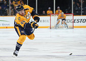 Cody Franson of the Nashville Predators fires a shot against the Colorado Avalanche during an NHL game at Bridgestone Arena on February 24 2015 in...