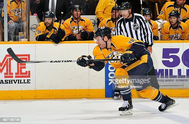 Cody Franson of the Nashville Predators fires a shot during the second period of a game against the Buffalo Sabres at Bridgestone Arena on March 21...