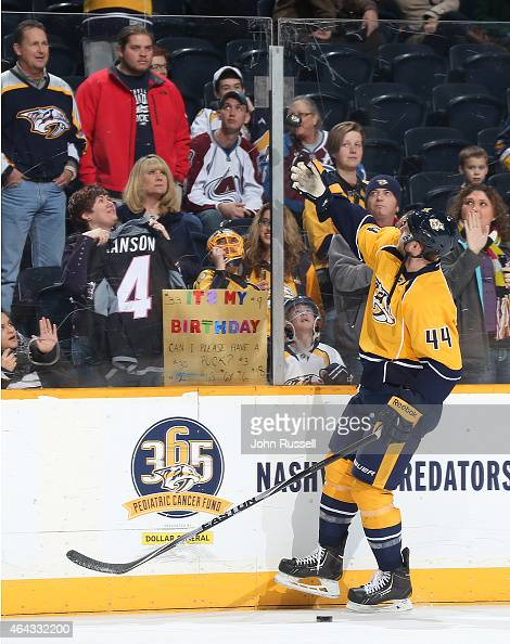 Cody Franson of the Nashville Predators grants a birthday wish to fan during warmups against the Colorado Avalanche prior to an NHL game at...