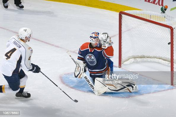 Cody Franson of the Nashville Predators puts the game winning shootout goal past Devan Dubnyk of the Edmonton Oilers at Rexall Place on January 23...