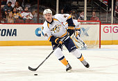 Cody Franson of the Nashville Predators skates with the puck against the Arizona Coyotes at Gila River Arena on March 9 2015 in Glendale Arizona