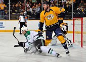 Cody Franson of the Nashville Predators stands over Ryan Garbutt of the Dallas Stars during the second period at Bridgestone Arena on April 4 2015 in...
