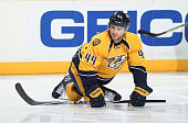 Cody Franson of the Nashville Predators stretches in warmups prior to a game against the Colorado Avalanche during an NHL game at Bridgestone Arena...
