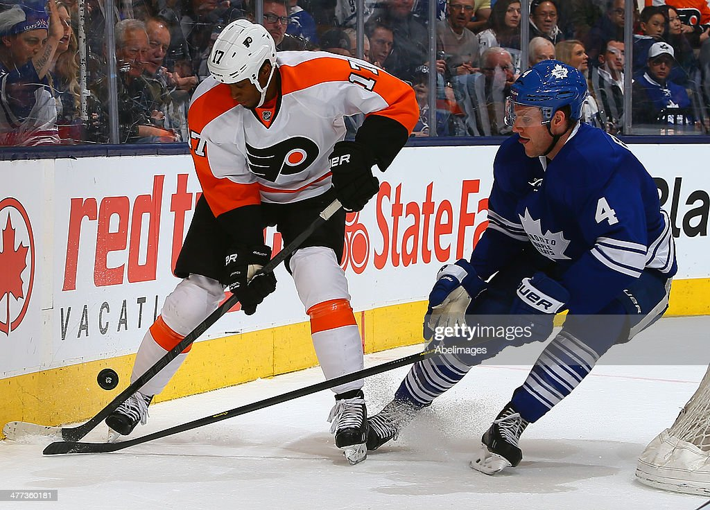 <a gi-track='captionPersonalityLinkClicked' href=/galleries/search?phrase=Cody+Franson&family=editorial&specificpeople=2125769 ng-click='$event.stopPropagation()'>Cody Franson</a> #4 of the Toronto Maple Leafs battles for the puck against <a gi-track='captionPersonalityLinkClicked' href=/galleries/search?phrase=Wayne+Simmonds&family=editorial&specificpeople=4212617 ng-click='$event.stopPropagation()'>Wayne Simmonds</a> #17 of the Philadelphia Flyers during NHL action at the Air Canada Centre March 8, 2014 in Toronto, Ontario, Canada.