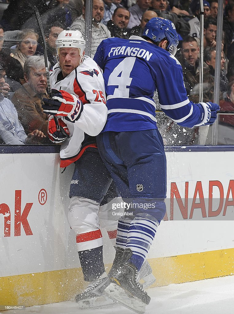 <a gi-track='captionPersonalityLinkClicked' href=/galleries/search?phrase=Cody+Franson&family=editorial&specificpeople=2125769 ng-click='$event.stopPropagation()'>Cody Franson</a> #4 of the Toronto Maple Leafs checks <a gi-track='captionPersonalityLinkClicked' href=/galleries/search?phrase=Jason+Chimera&family=editorial&specificpeople=211264 ng-click='$event.stopPropagation()'>Jason Chimera</a> #25 of the Washington Capitals during NHL game action January 31, 2013 at the Air Canada Centre in Toronto, Ontario, Canada.