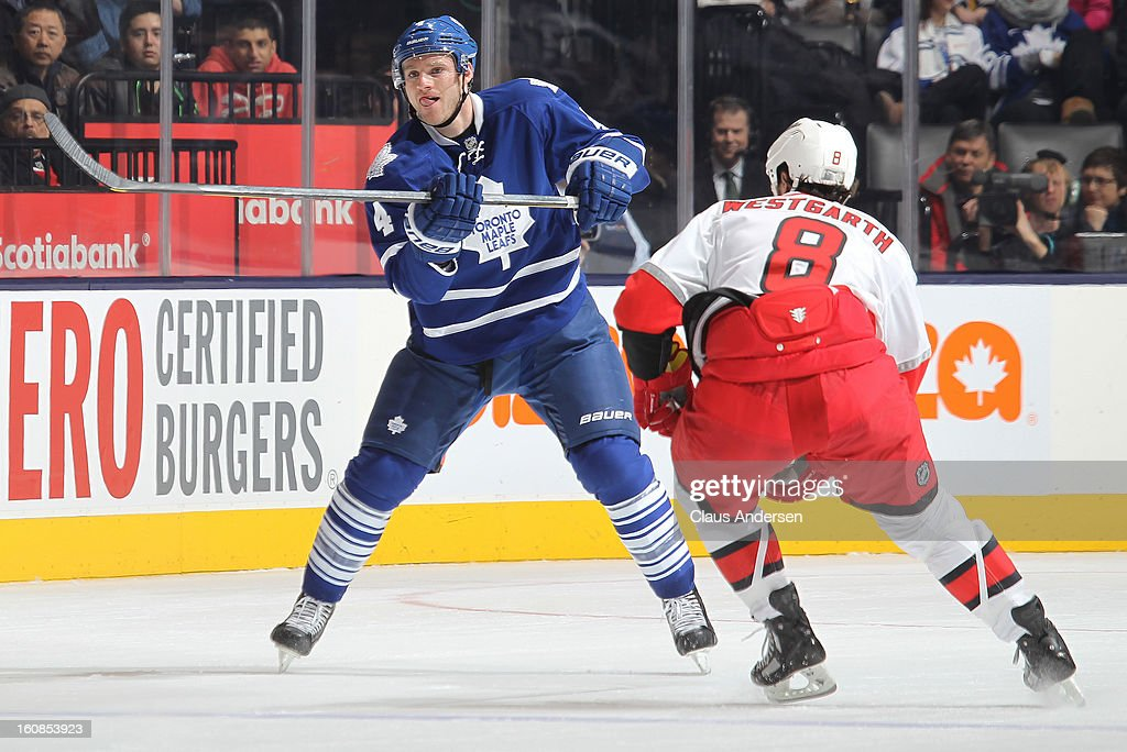 Cody Franson #4 of the Toronto Maple Leafs fires a puck up ice in a game against the Carolina Hurricanes on February 4, 2013 at the Air Canada Centre in Toronto, Canada. The Hurricanes defeated the Leafs 4-1.