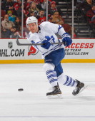 Cody Franson of the Toronto Maple Leafs plays the puck against the New Jersey Devils during the game at the Prudential Center on March 23 2014 in...