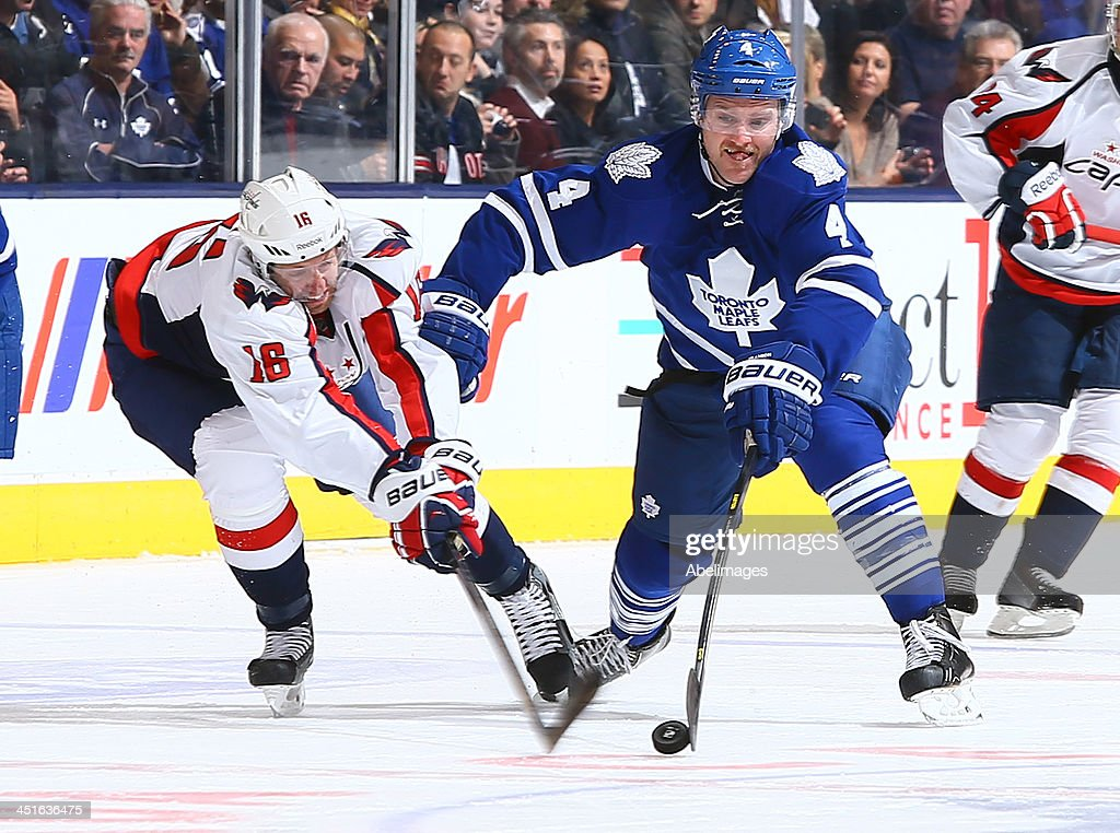 <a gi-track='captionPersonalityLinkClicked' href=/galleries/search?phrase=Cody+Franson&family=editorial&specificpeople=2125769 ng-click='$event.stopPropagation()'>Cody Franson</a> #4 of the Toronto Maple Leafs pokes the puck off of <a gi-track='captionPersonalityLinkClicked' href=/galleries/search?phrase=Eric+Fehr&family=editorial&specificpeople=566939 ng-click='$event.stopPropagation()'>Eric Fehr</a> #16 of the Washington Capitals during NHL action at the Air Canada Centre November 23, 2013 in Toronto, Ontario, Canada.
