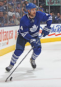Cody Franson of the Toronto Maple Leafs skates with the puck against the Vancouver Canucks during an NHL game at the Air Canada Centre on December 6...