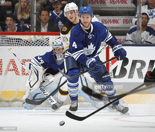 Cody Franson of the Toronto Maple Leafs watches an incoming shot against the Boston Bruins in Game Four of the Eastern Conference Quarterfinals...