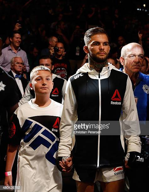 Cody Garbrandt and a young fan walk to the Octagon during the UFC 189 event inside MGM Grand Garden Arena on July 11 2015 in Las Vegas Nevada