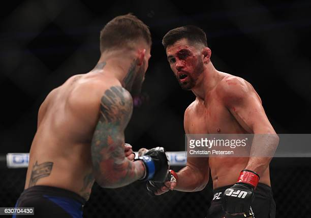 Cody Garbrandt and Dominick Cruz face off in their UFC bantamweight championship bout during the UFC 207 event on December 30 2016 in Las Vegas Nevada