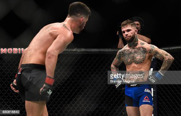 Cody Garbrandt and Dominick Cruz taunt each other in their UFC bantamweight championship bout during the UFC 207 event at TMobile Arena on December...