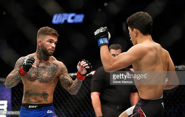 Cody Garbrandt and Takeya Mizugaki square off during their bantamweight bout at the UFC 202 event at TMobile Arena on August 20 2016 in Las Vegas...