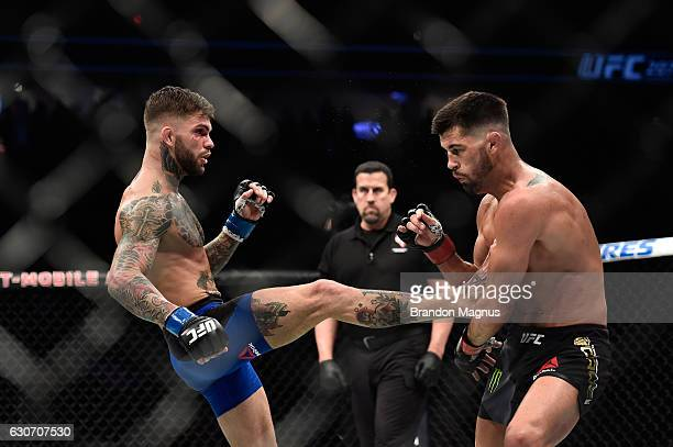 Cody Garbrandt kicks Dominick Cruz in their UFC bantamweight championship bout during the UFC 207 event at TMobile Arena on December 30 2016 in Las...