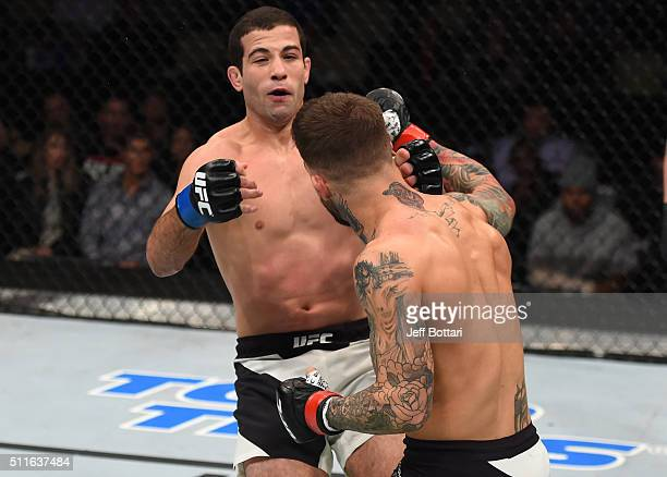 Cody Garbrandt punches Augusto Mendes in their bantamweight bout during the UFC Fight Night event at Consol Energy Center on February 21 2016 in...