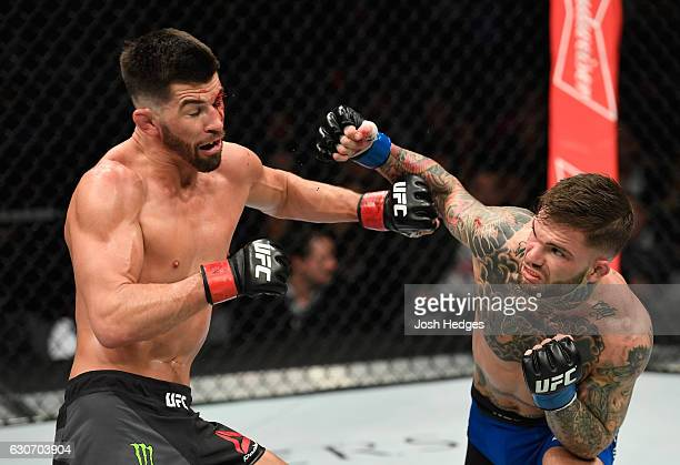 Cody Garbrandt punches Dominick Cruz in their UFC bantamweight championship bout during the UFC 207 event at TMobile Arena on December 30 2016 in Las...
