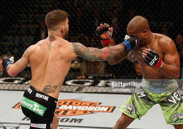 Cody Garbrandt punches Marcus Brimage in their bantamweight bout during the UFC 182 event at the MGM Grand Garden Arena on January 3 2015 in Las...
