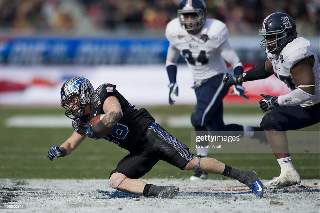 Cody Getz #28 of the Air Force Falcons dives for extra yards against the Rice Owls on December 29, 2012 during the Bell Helicopter Armed Forces Bowl at Amon G. Carter Stadium in Fort Worth, Texas.