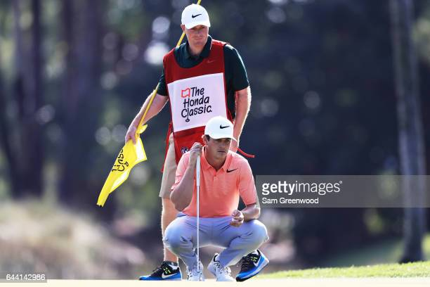 Cody Gribble of the United States lines up a putt for birdie on the seventh green during the first round of The Honda Classic at PGA National Resort...