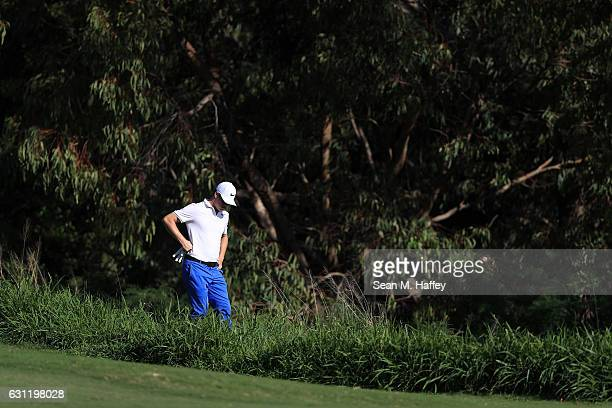 Cody Gribble of the United States looks for a ball during the third round of the SBS Tournament of Champions at the Plantation Course at Kapalua Golf...