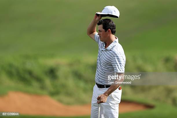 Cody Gribble of the United States reacts on the 18th green during the first round of the SBS Tournament of Champions at the Plantation Course at...