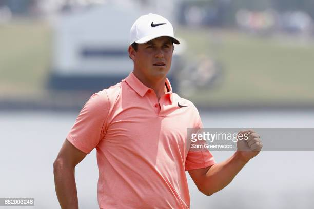 Cody Gribble of the United States reacts to his birdie putt on the 18th green during the first round of THE PLAYERS Championship at the Stadium...