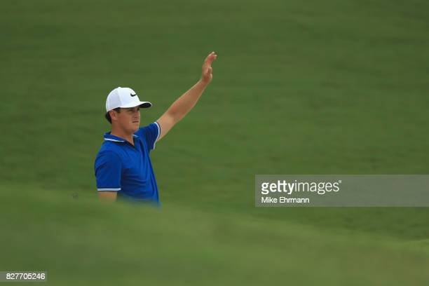Cody Gribble of the United States reacts to his shot during a practice round prior to the 2017 PGA Championship at Quail Hollow Club on August 8 2017...