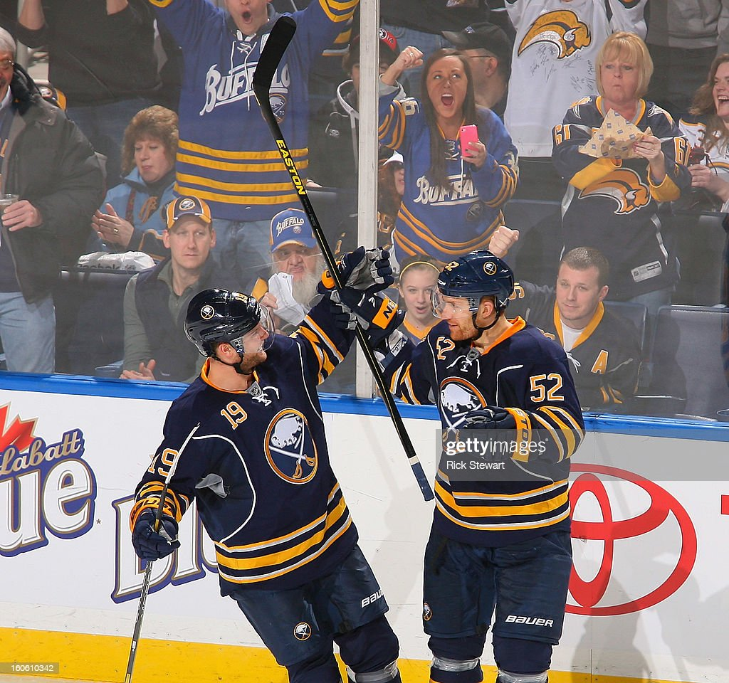 Cody Hodgson #19 and Alexander Sulzer #52 of the Buffalo Sabres celebrate Sulzer's goal in the second period against the Florida Panthers at First Niagara Center on February 3, 2013 in Buffalo, New York.
