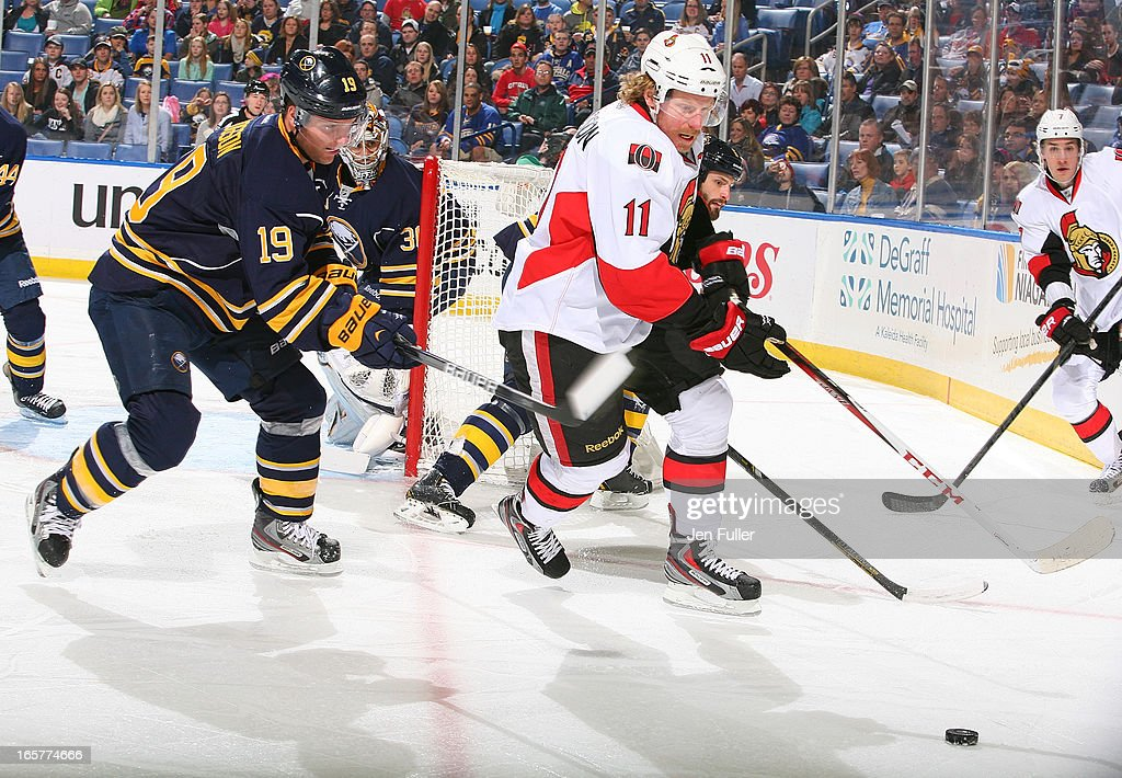 <a gi-track='captionPersonalityLinkClicked' href=/galleries/search?phrase=Cody+Hodgson&family=editorial&specificpeople=4151192 ng-click='$event.stopPropagation()'>Cody Hodgson</a> #19 of the Buffalo Sabres and <a gi-track='captionPersonalityLinkClicked' href=/galleries/search?phrase=Daniel+Alfredsson&family=editorial&specificpeople=201853 ng-click='$event.stopPropagation()'>Daniel Alfredsson</a> #11 of the Ottawa Senators battle for the puck on April 05, 2013 at the First Niagara Center in Buffalo, New York.