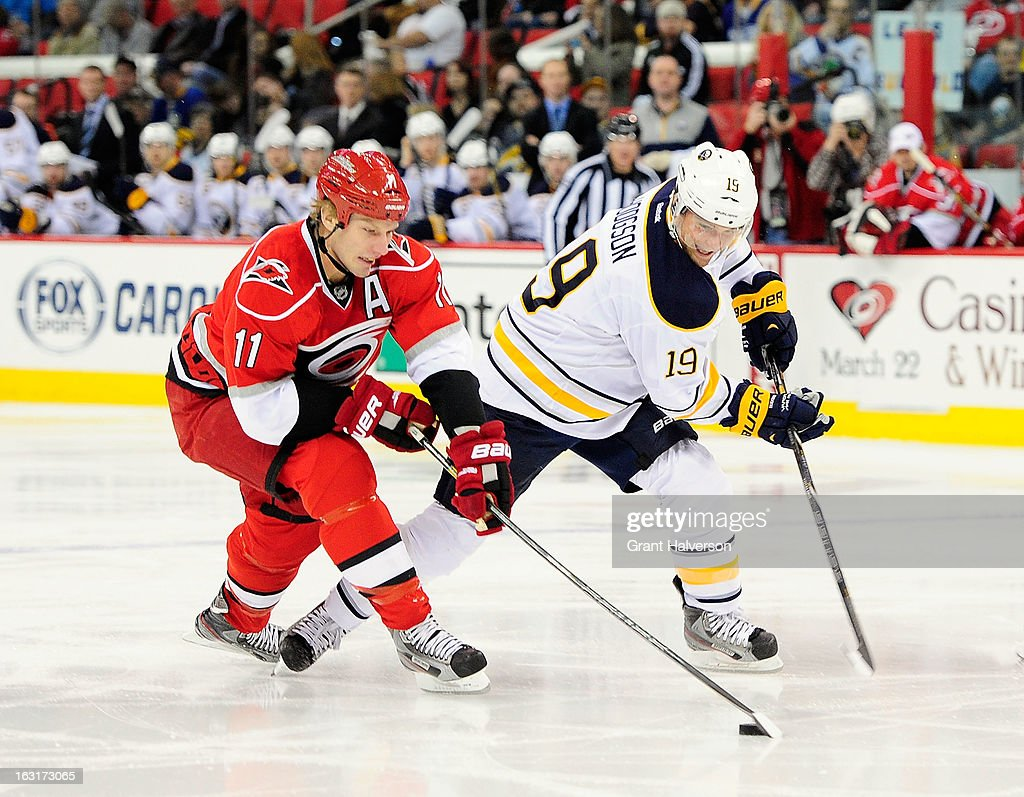 <a gi-track='captionPersonalityLinkClicked' href=/galleries/search?phrase=Cody+Hodgson&family=editorial&specificpeople=4151192 ng-click='$event.stopPropagation()'>Cody Hodgson</a> #19 of the Buffalo Sabres battles for the puck with <a gi-track='captionPersonalityLinkClicked' href=/galleries/search?phrase=Jordan+Staal&family=editorial&specificpeople=533044 ng-click='$event.stopPropagation()'>Jordan Staal</a> #12 of the Carolina Hurricanes during play at PNC Arena on March 5, 2013 in Raleigh, North Carolina.