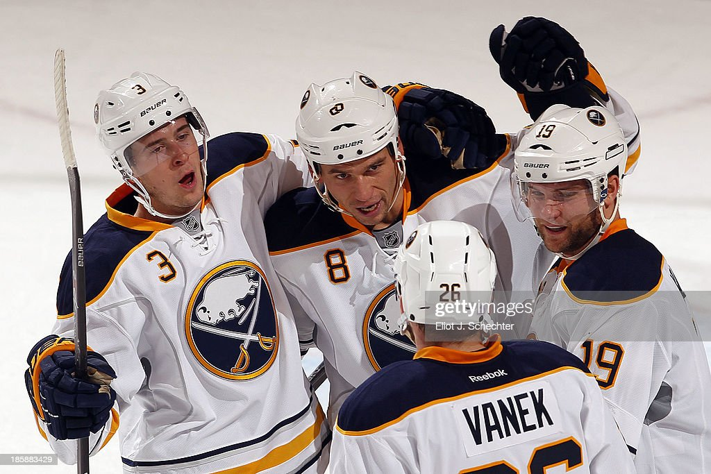 <a gi-track='captionPersonalityLinkClicked' href=/galleries/search?phrase=Cody+Hodgson&family=editorial&specificpeople=4151192 ng-click='$event.stopPropagation()'>Cody Hodgson</a> #19 of the Buffalo Sabres celebrates his empty net goal with teammates against the Florida Panthers at the BB&T Center on October 25, 2013 in Sunrise, Florida.