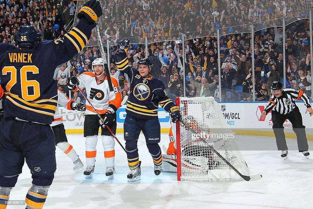 <a gi-track='captionPersonalityLinkClicked' href=/galleries/search?phrase=Cody+Hodgson&family=editorial&specificpeople=4151192 ng-click='$event.stopPropagation()'>Cody Hodgson</a> #19 of the Buffalo Sabres celebrates his third period goal with teammate Thomas Vanek #26 alongside <a gi-track='captionPersonalityLinkClicked' href=/galleries/search?phrase=Jakub+Voracek&family=editorial&specificpeople=4111797 ng-click='$event.stopPropagation()'>Jakub Voracek</a> #93 of the Philadelphia Flyers on January 20, 2013 at the First Niagara Center in Buffalo, New York. Vanek had five points and Buffalo defeated Philadelphia, 5-2.
