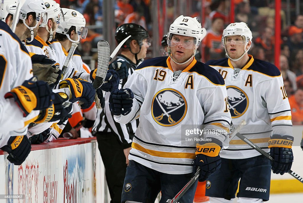<a gi-track='captionPersonalityLinkClicked' href=/galleries/search?phrase=Cody+Hodgson&family=editorial&specificpeople=4151192 ng-click='$event.stopPropagation()'>Cody Hodgson</a> #19 of the Buffalo Sabres celebrates his third period goal against the Philadelphia Flyers with his teamamtes on April 6, 2014 at the Wells Fargo Center in Philadelphia, Pennsylvania. The Flyers went on to defeat the Sabres 5-2.