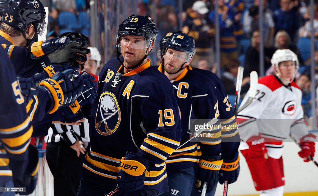 <a gi-track='captionPersonalityLinkClicked' href=/galleries/search?phrase=Cody+Hodgson&family=editorial&specificpeople=4151192 ng-click='$event.stopPropagation()'>Cody Hodgson</a> #19 of the Buffalo Sabres celebrates his third-period goal with teammates along the bench in their game against the Carolina Hurricanes at First Niagara Center on September 19, 2013 in Buffalo, United States.