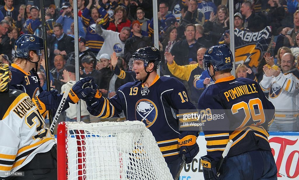 <a gi-track='captionPersonalityLinkClicked' href=/galleries/search?phrase=Cody+Hodgson&family=editorial&specificpeople=4151192 ng-click='$event.stopPropagation()'>Cody Hodgson</a> #19 of the Buffalo Sabres celebrates with Tyler Myers #57 and Jason Pominville #29 after scoring a third period goal against the Boston Bruins on February 15, 2013 at the First Niagara Center in Buffalo, New York. Buffalo defeated Boston, 4-2.
