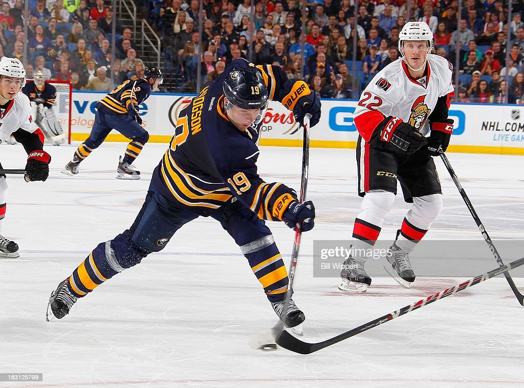 Cody Hodgson #19 of the Buffalo Sabres fires a third-period slapshot alongside Erik Condra #22 of the Ottawa Senators on October 4, 2013 at the First Niagara Center in Buffalo, New York.