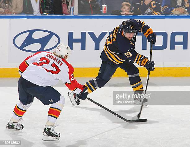 Cody Hodgson of the Buffalo Sabres gets off a shot against Alex Kovalev of the Florida Panthers at First Niagara Center on February 3 2013 in Buffalo...