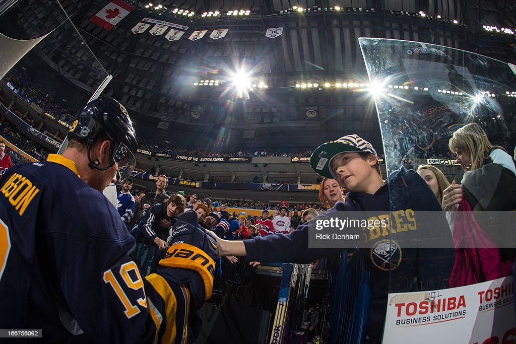 Cody Hodgson #19 of the Buffalo Sabres gives a young fan high five while leaving the ice after warm up prior to the game against the Montreal Canadiens at First Niagara Center on April 11, 2013 in Buffalo, New York.