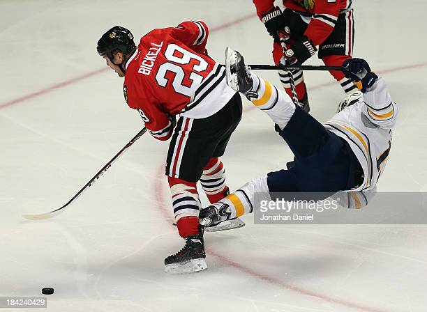 Cody Hodgson of the Buffalo Sabres goes flying in the air after colliding with Bryan Bickell of the Chicago Blackhawks at the United Center on...