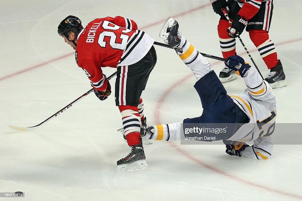 <a gi-track='captionPersonalityLinkClicked' href=/galleries/search?phrase=Cody+Hodgson&family=editorial&specificpeople=4151192 ng-click='$event.stopPropagation()'>Cody Hodgson</a> #19 of the Buffalo Sabres goes flying in the air after colliding with <a gi-track='captionPersonalityLinkClicked' href=/galleries/search?phrase=Bryan+Bickell&family=editorial&specificpeople=241498 ng-click='$event.stopPropagation()'>Bryan Bickell</a> #29 of the Chicago Blackhawks at the United Center on October 12, 2013 in Chicago, Illinois.
