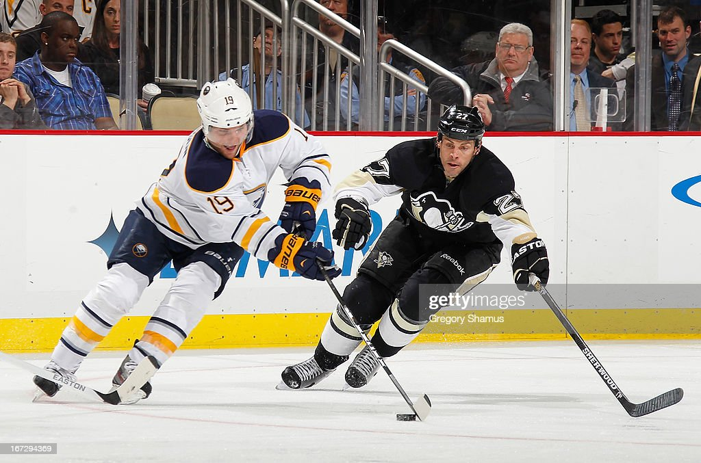 <a gi-track='captionPersonalityLinkClicked' href=/galleries/search?phrase=Cody+Hodgson&family=editorial&specificpeople=4151192 ng-click='$event.stopPropagation()'>Cody Hodgson</a> #19 of the Buffalo Sabres moves the puck in front of <a gi-track='captionPersonalityLinkClicked' href=/galleries/search?phrase=Craig+Adams&family=editorial&specificpeople=211144 ng-click='$event.stopPropagation()'>Craig Adams</a> #27 of the Pittsburgh Penguins on April 23, 2013 at Consol Energy Center in Pittsburgh, Pennsylvania. Buffalo won the game 4-2.