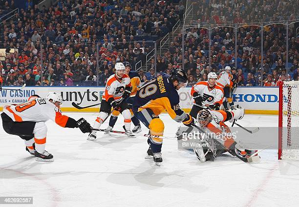 Cody Hodgson of the Buffalo Sabres scores a first period goal just out of reach of Steve Mason and Vincent Lecavalier of the Philadelphia Flyers on...