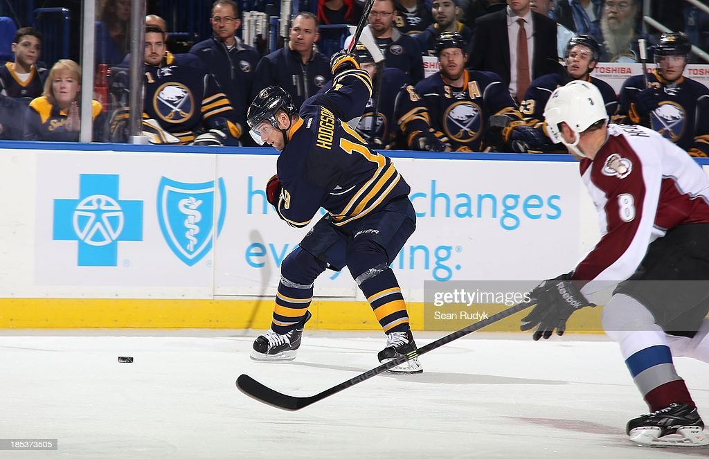 Cody Hodgson #19 of the Buffalo Sabres scores on a second-period slapshot alongside Jan Hejda #8 of the Colorado Avalanche on October 19, 2013 at the First Niagara Center in Buffalo, New York.