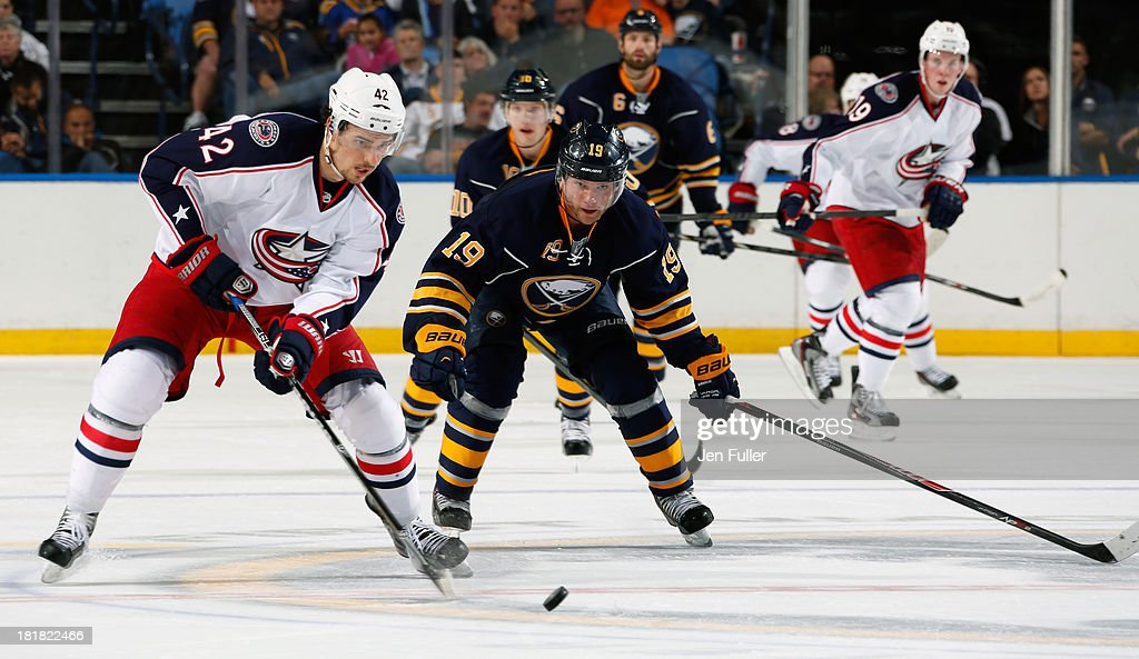 <a gi-track='captionPersonalityLinkClicked' href=/galleries/search?phrase=Cody+Hodgson&family=editorial&specificpeople=4151192 ng-click='$event.stopPropagation()'>Cody Hodgson</a> #19 of the Buffalo Sabres skates after <a gi-track='captionPersonalityLinkClicked' href=/galleries/search?phrase=Artem+Anisimov&family=editorial&specificpeople=543215 ng-click='$event.stopPropagation()'>Artem Anisimov</a> #42 of the Columbus Blue Jackets during their preseason game at First Niagara Center on September 25, 2013 in Buffalo, New York. Buffalo defeated Columbus, 3-0.