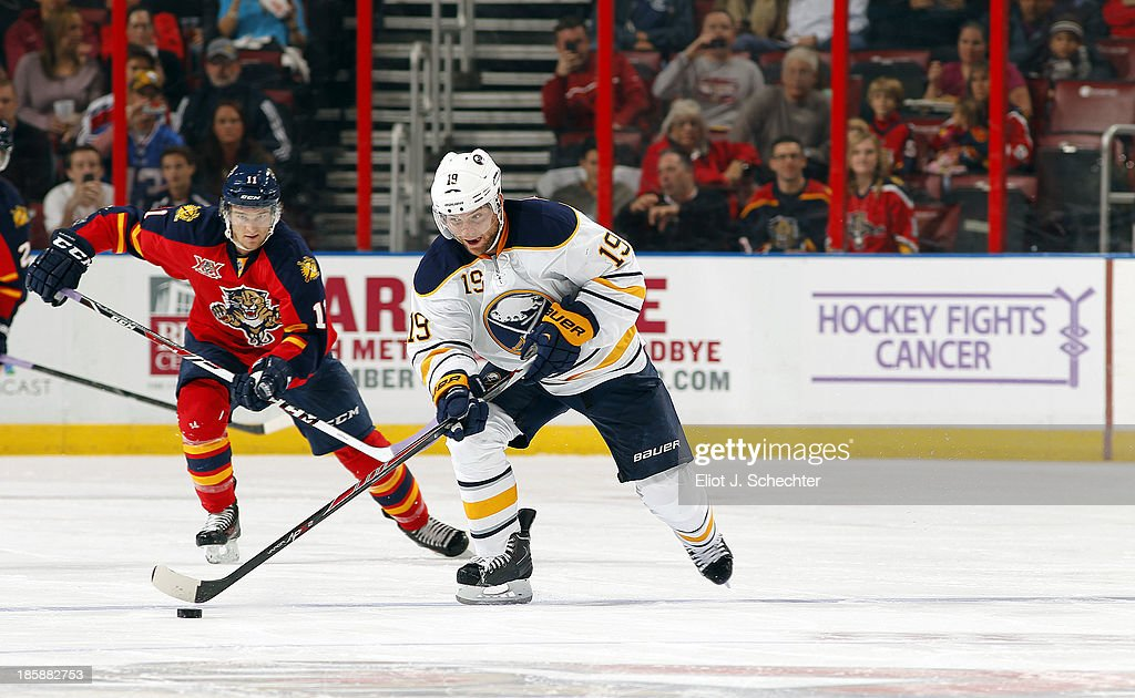 Cody Hodgson #19 of the Buffalo Sabres skates with the puck against Jonathan Huberdeau #11 of the Florida Panthers at the BB&T Center on October 25, 2013 in Sunrise, Florida.